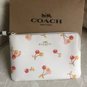 NWT Coach  chalk color cherry center zip wristlet